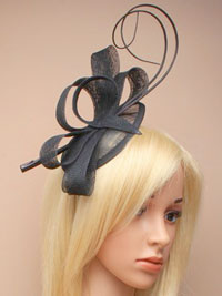 Fascinator / Zara - Black sinamay pointed cap fascinator.
