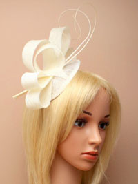Fascinator / Zara - Cream sinamay pointed cap fascinator.