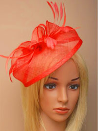 Fascinator / Olivia - Coral Large looped sinamay hatinator.